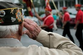 Veteran saluting as National Emblem passes in parade