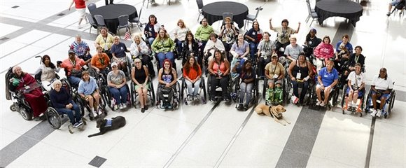 Women veterans post together between events at the 34th National Veterans Wheelchair Games