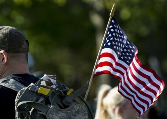 Soldier with American flag in backpack