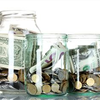 Donation jars with cash inside