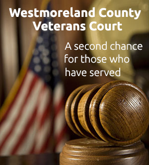 Judge&#39s gavel on desk with US flag in background