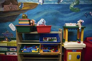Toys, books and mural in Westmoreland Family Court Comfort Room for kids
