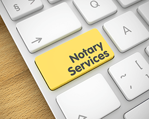 Keyboard With Notary Services Printed On A Key Opens In New Window