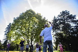 Tai Chi class outside McKenna Center for Active Adults