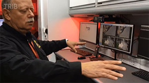 Bud Mertz demonstrating interior features of Mobile Command Center