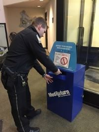 Patrolman at drug take back box