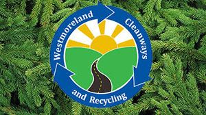 Live Christmas tree needles in background with Westmoreland Cleanways logo