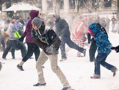 Happy people in a snowball fight