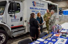 Mobile Veterans service outreach van at PA Farm Show with staff and visitors