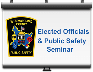 Projector screen with Westmoreland County Public Safety badge