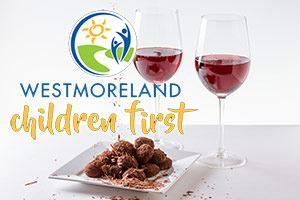 Two glasses of wine, chocolate truffles and Westmoreland Children First Logo