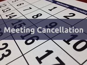 Calendar page with words Meeting Cancellation