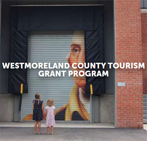 Two children looking at mural with words Westmoreland County Tourism Grant