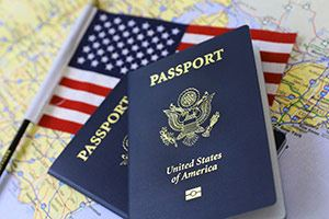 US Passport on a map with a small American flag