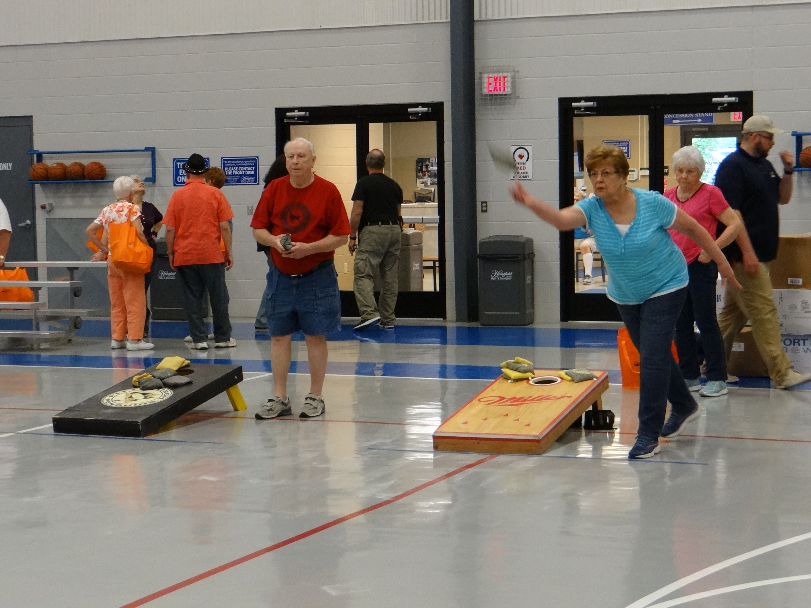 Senior Games corn hole competitors