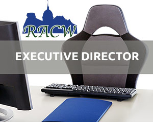 RACW logo with empty desk chair and words Executive Director